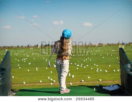 Luttle Girl Swinging Golf Club