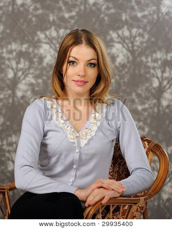 Portrait Of Beautiful Woman Sitting On A Chair