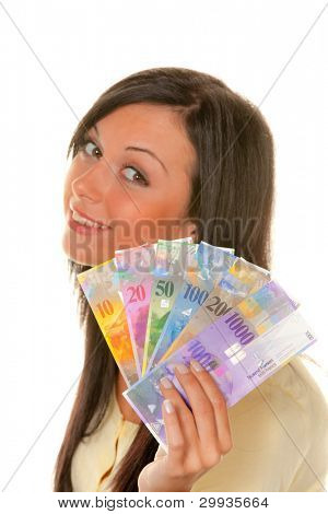 young woman holding swiss francs in hand