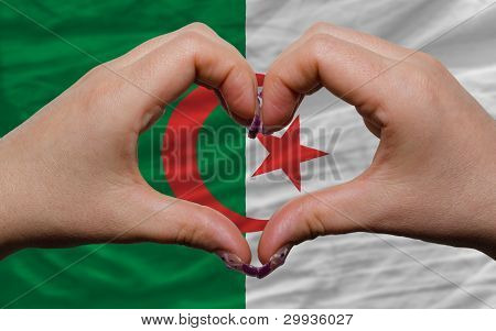 Over National Flag Of Algeria Showed Heart And Love Gesture Made By Hands