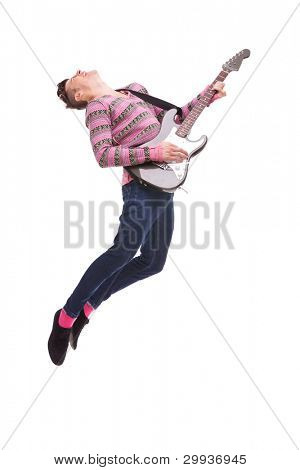 picture of a casual young man jumping in the air while playing an electic guitar on white background. passionate guitarist jumps in the air. rock and roll image with a young performer jumping