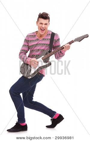 passionate guitarist playing an electric guitar on white background. rock and roll image of a young casual man playing a guitar.