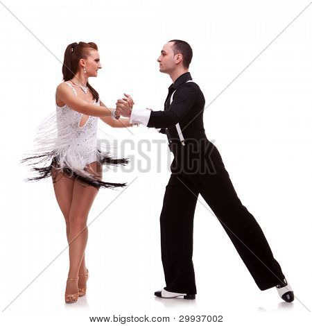 Dancing young couple on a white background. Passionate salsa dancers
