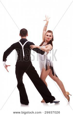 rear view of a male dancer holding his female partner in a difficult dance move. back of a latino dancing couple on white background. passionate latino dancing couple