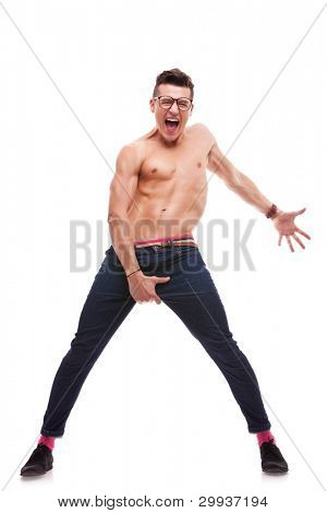 excited shirtless man screaming on white background. sexy muscular man wearing glasses and no shirt shouting and gesturing