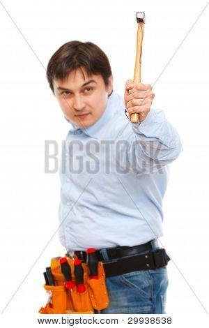 Construction Worker Brandishing Hammer In Camera|focus On Hammer