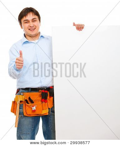 Construction Worker Holding Blank Billboard And Showing Thumbs Up