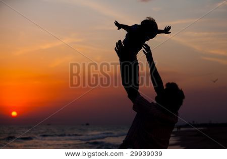 Father and little son silhouettes