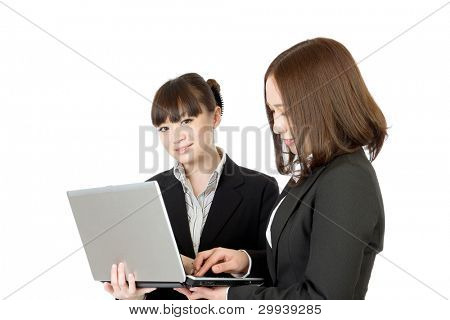 Beautiful business women working in team together on laptop computer. Portrait of asian woman.
