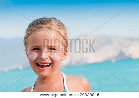 Summer vacation - portrait of lovely girl on the beach