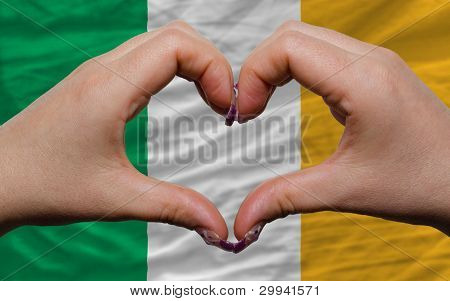 Over National Flag Of Ireland Showed Heart And Love Gesture Made By Hands