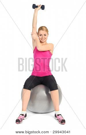 Young woman doing Seated Dumbbell One Arm Triceps Extensions on Fitnes Ball, phase 2 of 2.