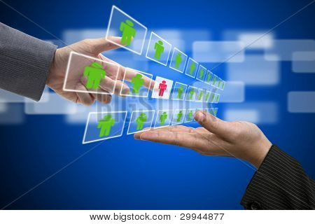 Business Hand select New Employee from Electronic interface using for Business Recruitment and Workforce Concept
