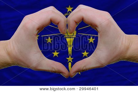 Over American State Flag Of Indiana Showed Heart And Love Gesture Made By Hands