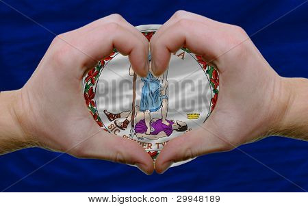 Over American State Flag Of Virginia Showed Heart And Love Gesture Made By Hands