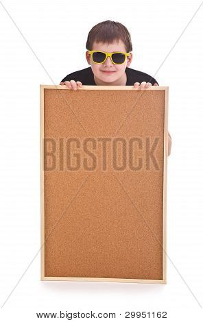 Young Boy And Empty Bulletin Board