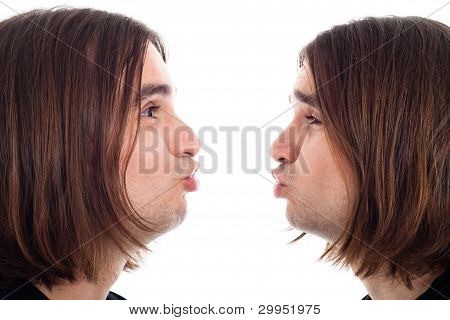 Profile Of Man Making Kiss Face
