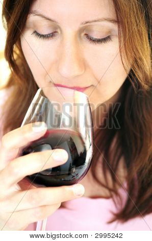 Mature Woman With A Glass Of Red Wine