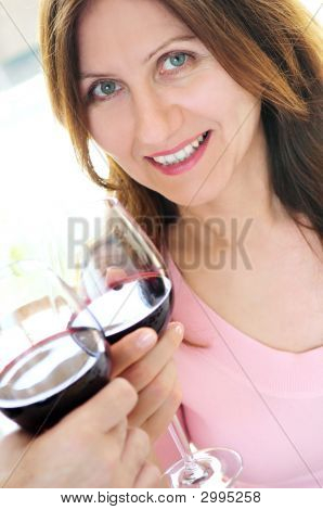 Mature Woman Toasting With Red Wine