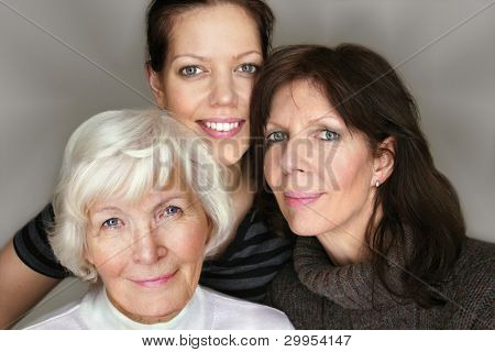 Senior woman and mature daughter and granddaughter portrait