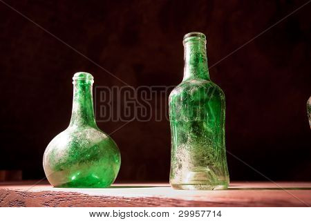 Dusty wine Bottles On The Table