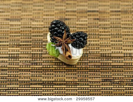 Small baskets with blackberry