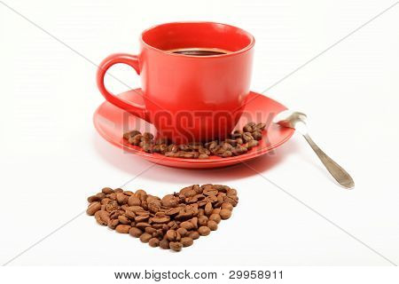 Heart Made ??from Coffee Beans Around A Cup Of Coffee On A White Background.