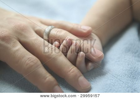 Father and baby hand in hand