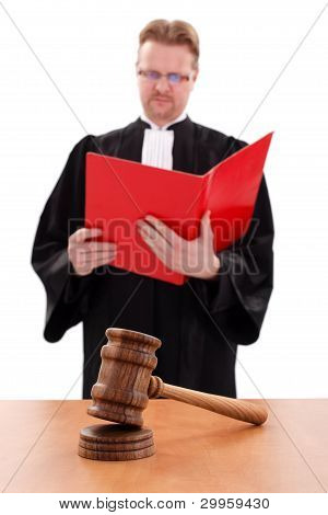 Justice Gavel In Front, Judge Reading In Back