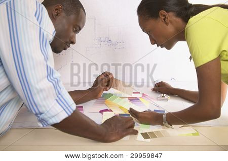 Young man and woman viewing color swatches
