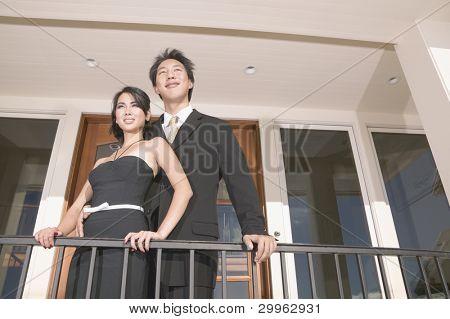 Portrait of couple on balcony