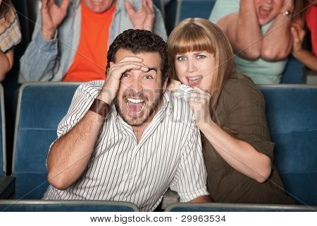 Frightened Couple In Theater
