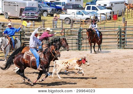 BOULDER - AUGUST 27th: unidentified cowboys ride in the calf roping competition at Jefferson County Fair and Rodeo on august 27, 2011 in Boulder, Montana