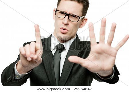 "Young handsome businessman in black suit making ""stop"" gesture."