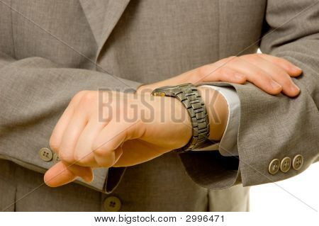 Businessman Checking The Time On His Watch