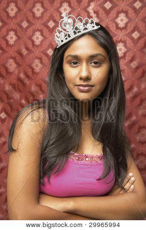 Teenage girl wearing crown