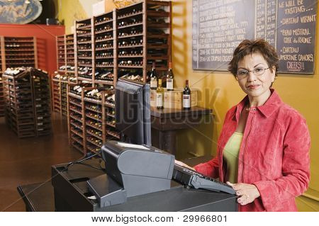 Portrait of woman selling wine