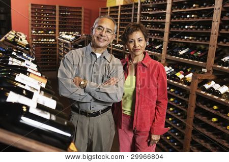 Portrait of couple in wine cellar