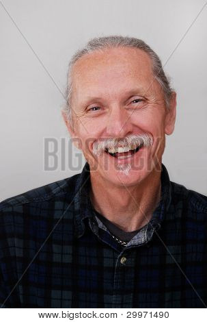 Smiling Middle-aged Man On White Background