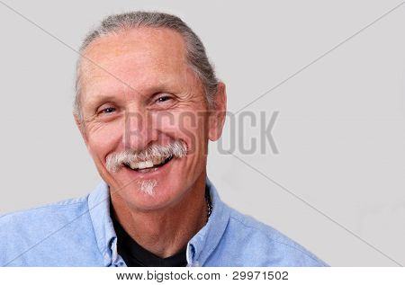 Smiling middle-aged man.