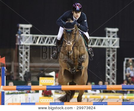 BUDAPEST, HUNGARY - DECEMBER 2: An unidentified competitor jumps with his horse at the OTP Equitation World Cup, December 2, 2011 in Budapest, Hungary