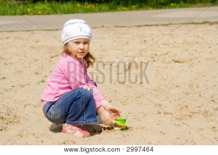 The Child In Sandbox