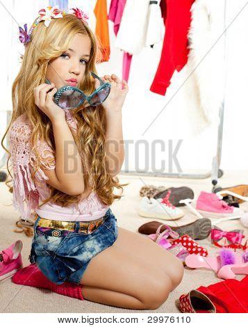 fashion victim kid girl wardrobe messy playing with sunglasses