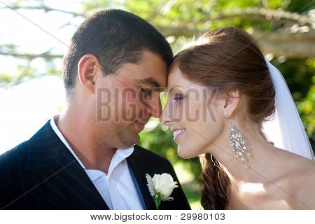 Newlyweds With Foreheads Lovingly Touching