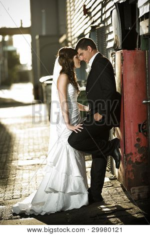 Newlyweds Embracing Against A Red Box