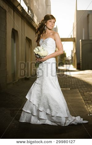 Beautiful Bride Posing In A Grungy Alley