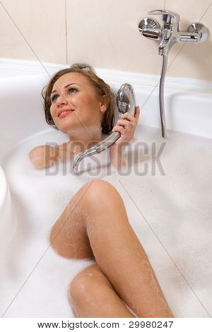 Sensual woman relaxing in bathtub with foam soap sud