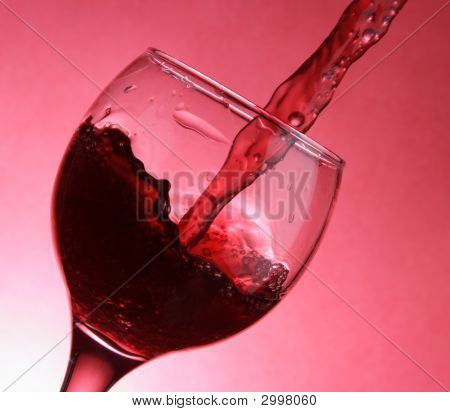 Closeup Of Pouring Wine