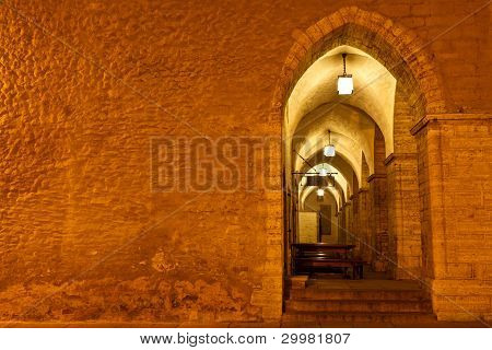 Archway In Tallinn Town Hall At Night In Raekoja Square, Estonia