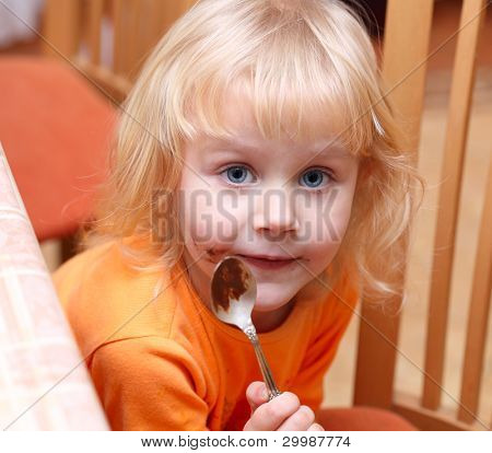 Small girl eating her chocolate